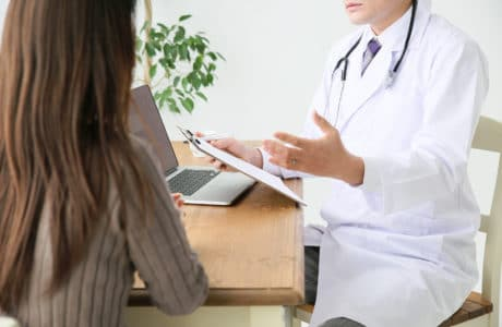 Doctor talking with a patient