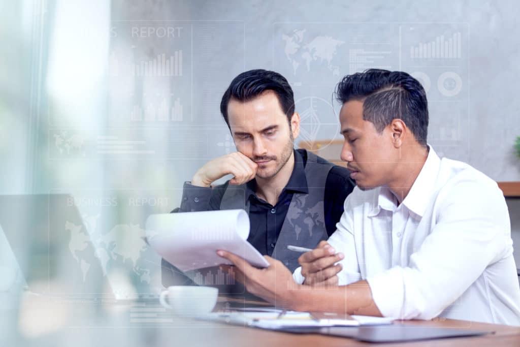Two man understanding papers